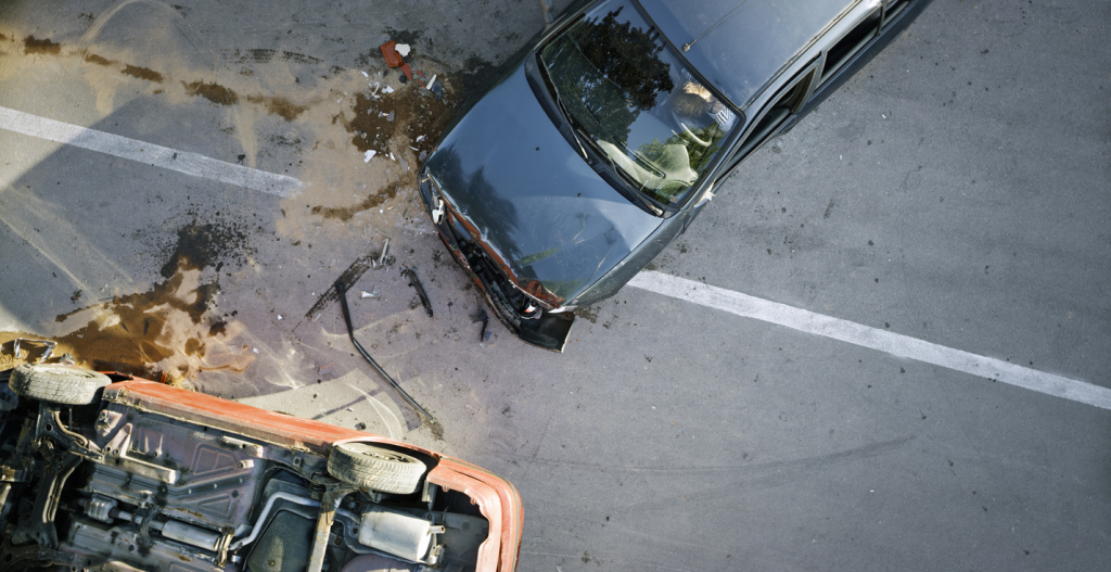 Elevated view of broken cars after accident.